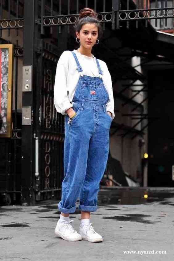 90s Outfits: white hoodie, denim overall, white sneakers, hoop earrings #outfitoftheday #hairstyle #white #retro