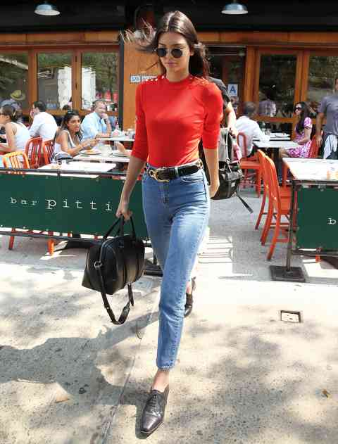 90s Outfit: red half sleeve top, high waisted skinny jeans, black belt, black handbag, sunglasses, monk shoes #outfitideas #90s #brunette #trendy