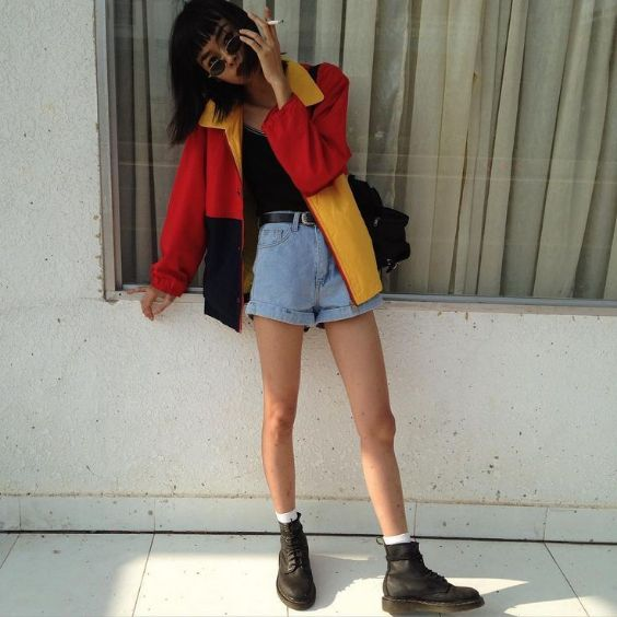 90s Outfit: yellow, red and black jacket, black top, denim shorts, black booties, black belt, sunglasses, black bag #outfit #blackhair #teen #look