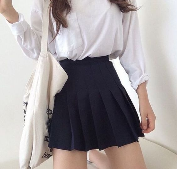 Aesthetic Outfit: white long sleeve top, black waist pleated mini skirt, white bag #outfit #girly #cute #fashion
