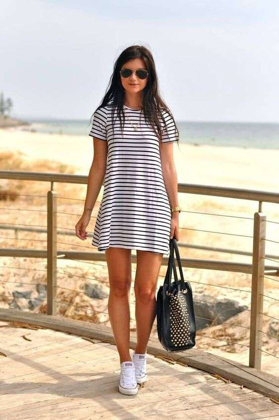 Beach Outfits: black and white striped short sleeve mini dress, white sneakers, black handbag, sunglasses, necklace #outfitideas #fashion #dailylook #brunette