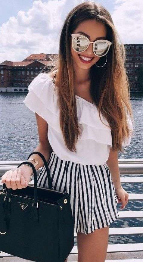 Beach Outfits: white one shoulder ruffle top, black and white striped shorts, black handbag, sunglasses, hoop earrings #outfitoftheday #pretty #elegant #sun
