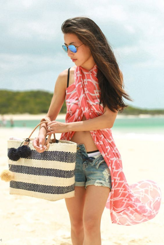 Beach Outfits: pink scarves, ripped denim shorts, navy blue and beige beach bag, sunglasses #outfitideas #girl #fashion #brunette
