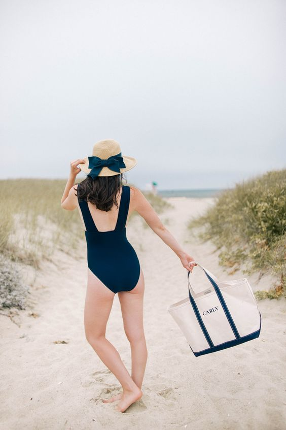 Beach Outfits: navy blue one piece swimsuit, bow sun hat, navy blue and beige beach bag #outfit #brunette #women #fashion