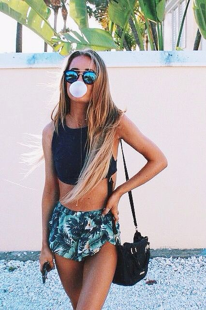 Beach Outfit: black halter crop top, palm print shorts, crossbody bag, sunglasses #outfitoftheday #longhair #sun #women