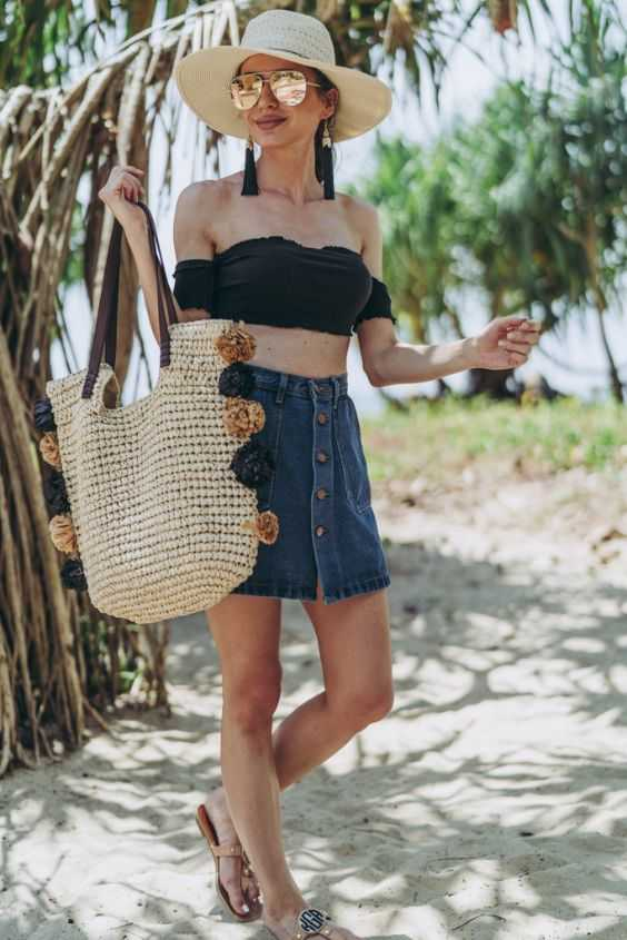 Beach Outfits: black off the shoulder crop top, denim skirt, extra large beach bag, floppy hat, sunglasses, earrings, sandals #outfit #beach #look #sun