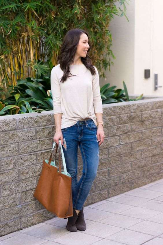 Business Casual Outfit: beige sweatshirt, ripped jeans, camel handbag, brown booties, watch #outfit #fashion #girly #brunette
