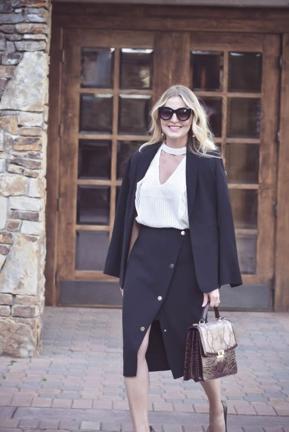 Business Casual Outfits: black blazer and wrap skirt set, white v-neck top, snake print handbag, sunglasses, black heels #outfitoftheday #blonde #woman #smile