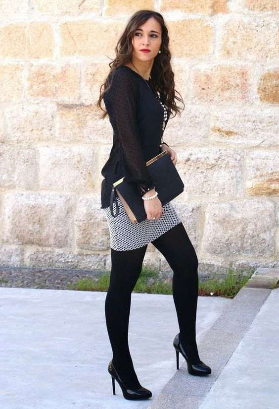 Business Casual Outfit: black bishop sleeve chiffon blouse, black and white skirt, black tights, black heels, black and golden purse, bracelets, necklace, pearl earrings #outfit #brunette #makeup #black