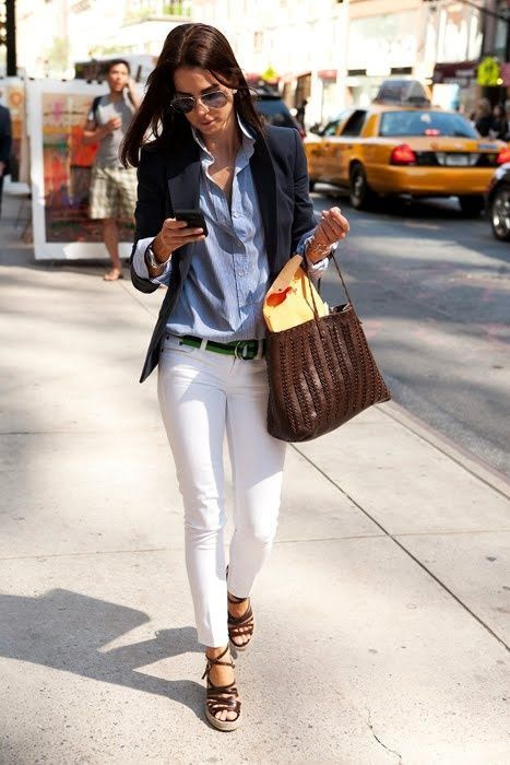 Business Casual Outfits: navy blue blazer, light blue shirt, white skinny pants, brown wedge shoes, brown handbag, black belt, watch, bracelets, sunglasses #outfit #fashion #woman #brunette