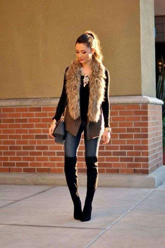 Casual Outfit: brown faux fur sleeveless jacket, black long sleeve top, skinny jeans, black high knee boots, necklace, black crossbody bag, bracelet #outfitoftheday #women #fashion #trendy
