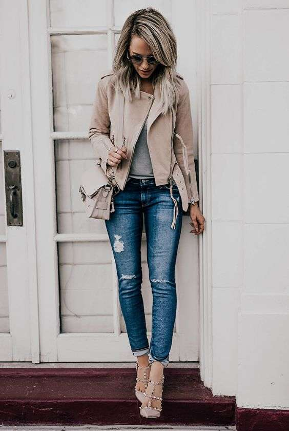 Casual Outfit: beige faux leather jacket, gray top, ripped jeans, nude heels, beige crossbody bag, sunglasses #outfitoftheday #blonde #casual #trendy