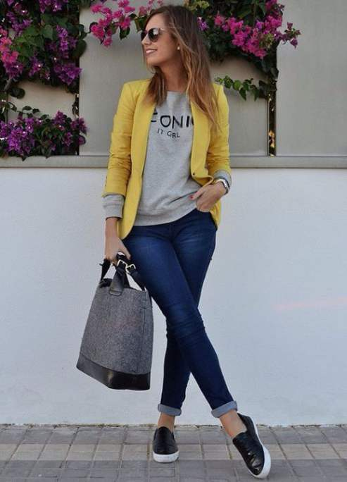 Casual Outfit: yellow blazer, gray sweater, skinny jeans, black slip-on shoes, black and gray handbag, sunglasses, earrings, bracelet #outfit #yellow #fashion #trendy