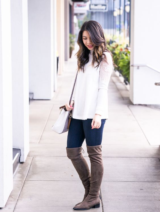 Casual Outfit: white sleeveless jacket, white long sleeve lace top, skinny jeans, brown high knee boots, white and brown crossbody bag #outfitideas #white #brunette #fashion