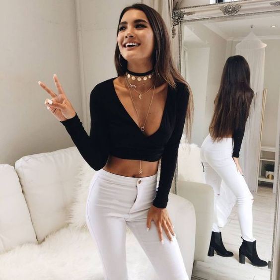 Club Outfits: black long sleeve v-neck crop top, white skinny pants, black booties, choker, necklace #outfit #blackandwhite #longhair #fashion
