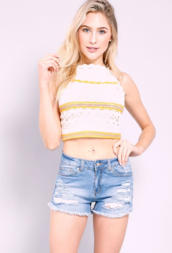Crop top Outfits: White and yellow halter lace crop top, ripped shorts, pierced earrings #outfitoftheday #blondhair #croptop #beauty