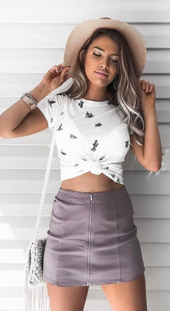 Crop Top Outfits: White cactus print knot crop top, gray faux-leather zip front mini skirt, light gray crochet boho bag, beige floppy hat, bracelets #outfitoftheday #summer  #sunhat #beachhats
