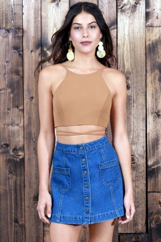 Crop top outfit: light brown cross front crop top, blue denim mini skirt, drop earrings #outfit #skirt #fashion #accessories