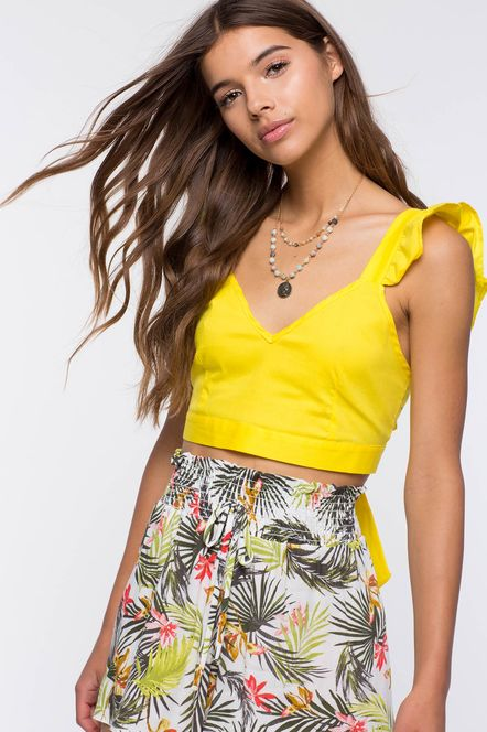 Crop top Outfit: Yellow sleeveless crop top, palm print pants, necklace #outfitideas #summer #makeup #beach