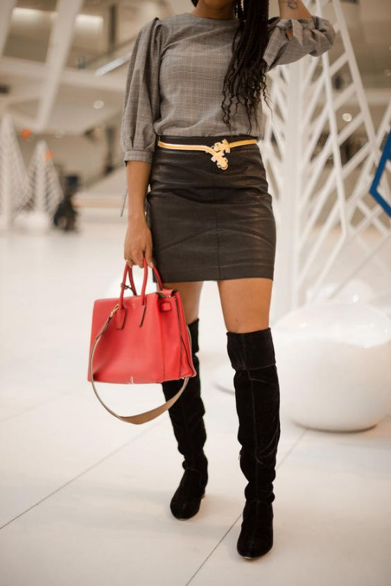 Date Night Outfit: gray bishop sleeve blouse, dark gray faux leather skirt, black knee high boots, golden belt, red handbag #outfitideas #longhair #black #girl