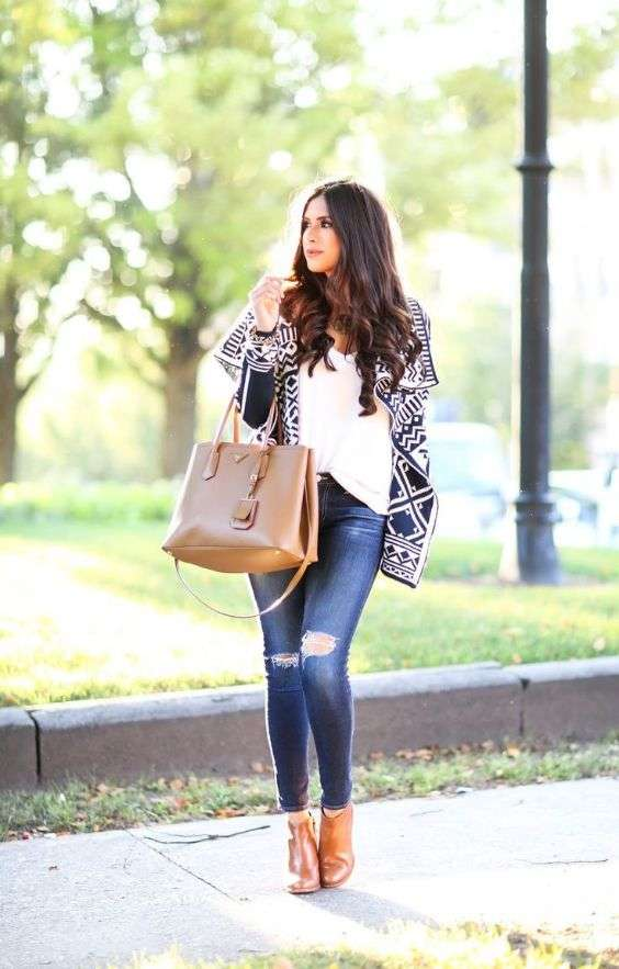 Date Night Outfit: black and white wool blanket poncho, white top, ripped jeans, camel booties, camel handbag #outfit #brunette #fashion #makeup