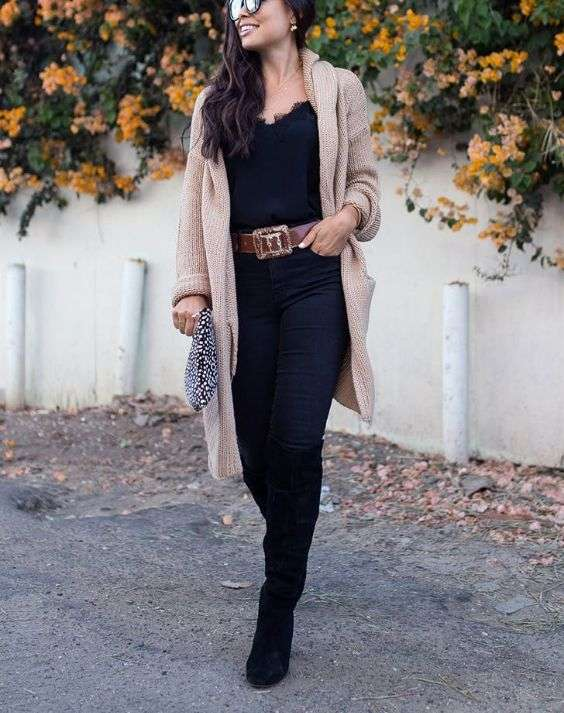 Date Night Outfit: beige crochet longline cardigan, black v-neck top, brown belt, black skinny jeans, black knee high boots, brown and white purse, sunglasses, earrings #outfit #brunette #girly #trendy
