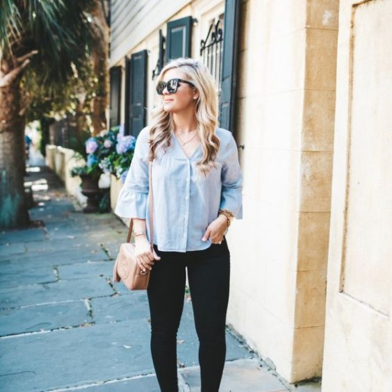 Date Night Outfits: light blue trumpet sleeve shirt, black skinny jeans, beige crossbody bag, sunglasses, bracelet #outfitideas #blonde #trendy #fashion