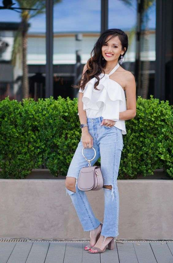 Date Night Outfits: white halter ruffle top, ripped jeans, beige heel sandals, beige purse, earrings, watch #outfit #brunette #makeup #smile