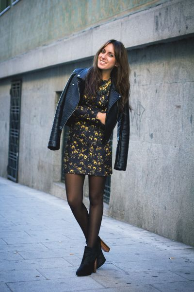 Date Night Outfit: black faux leather jacket, black floral dress, black tights, black booties, black and golden necklace #outfit #black #floral #girl