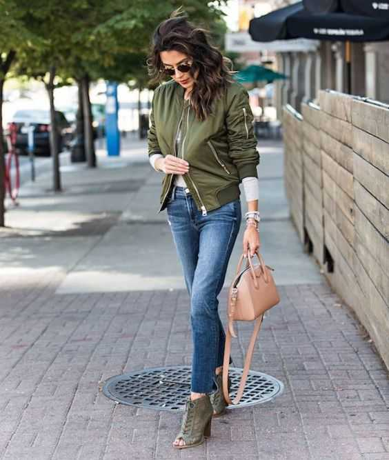 Fall Outfits: army green jacket, gray long sleeve sweater, skinny jeans, army green booties, brown handbag, sunglasses, bracelet #outfit #fall #brunette #girl