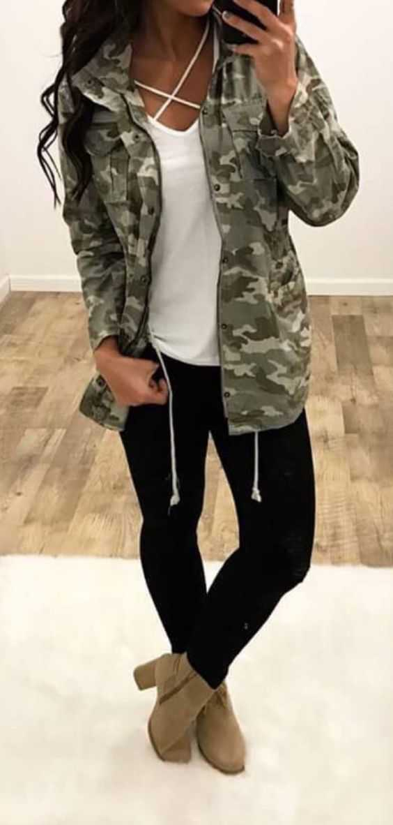 Fall Outfits: camouflage jacket, white cross front top, black ripped jeans, brown booties #outfitideas #girl #trendy #fashion