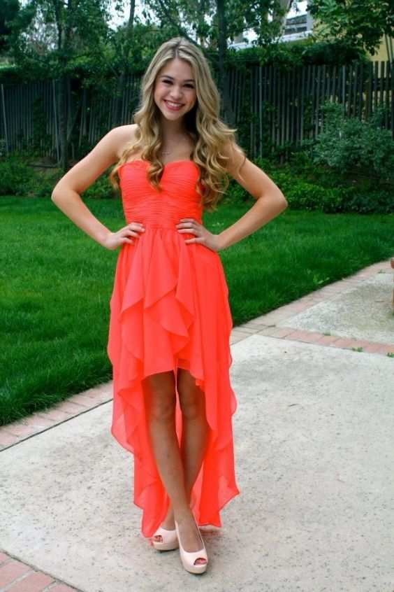 Graduation Outfits: orange strapless asymmetric chiffon dress, white heels #outfit #blonde #longhair #trendy