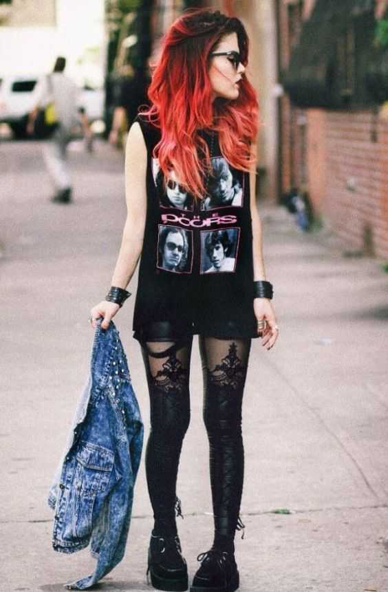 Grunge Outfits: black sleeveless top, black faux-leather shorts, black lace tights, denim jacket, black martens shoes, bracelets, sunglasses #outfit #redhair #trendy #rockstar