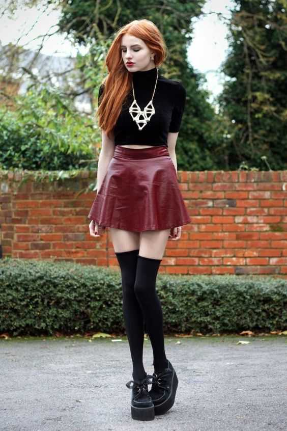 Grunge Outfit: black turtleneck half sleeve crop top, wine faux-leather mini skirt, black high knee socks, black martens shoes, necklace #outfit #redhair #makeup #teen
