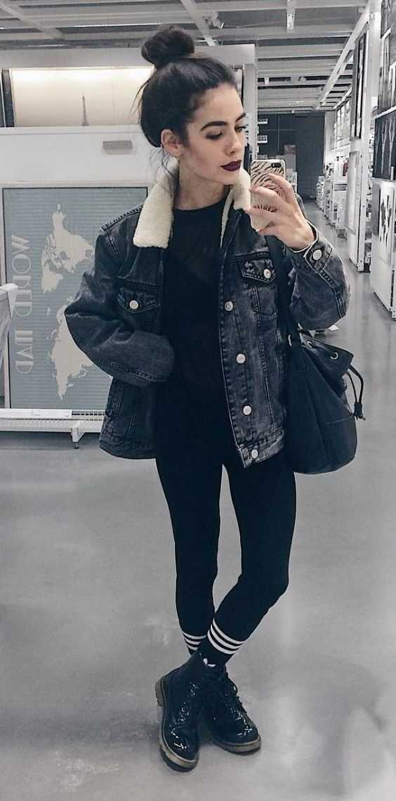 Grunge Outfits: black denim jacket, black top, black and white striped leggins, black booties, black bag #outfitoftheday #makeup #hair #fashion