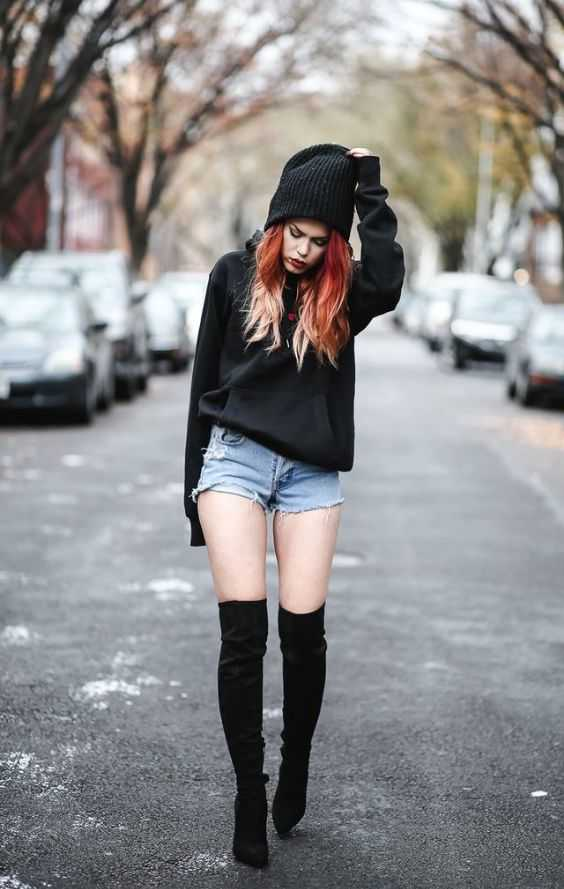 Grunge Outfit: black hoodie, denim shorts, black knee high boots, black winter hat #outfit #redhair #grunge #fashion