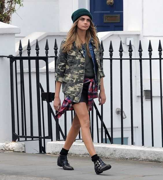 Grunge Outfit: camouflage jacket, army green shirt, black shorts, red lumberjack shirt, green winter hat, black booties #outfitoftheday #grunge #longhair #fashion