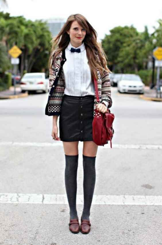Hipster Outfit: colorful cardigan, white shirt, black bow tie, black faux leather skirt, dark gray knee high socks, brown mocassins, red crossbody bag #outfitideas #chic #hipster #girly
