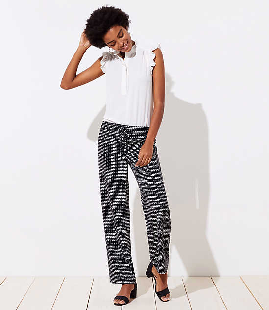 Interview Outfits: white ruffle sleeveless top, black and white checked pants, black chunky heels, hoop earrings #outfit #elegant #pretty #cute