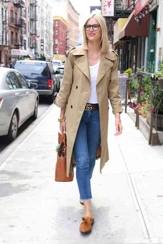 Interview Outfit: beige coat, white top, capri jeans, camel slip-on shoes, camel handbag, brown belt #outfitoftheday #glasses #blonde #woman