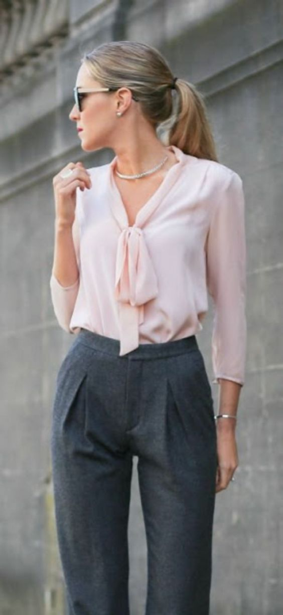 Interview Outfit: baby pink lace front long sleeve blouse, gray pleat front pants, bracelet, necklace, sunglasses #outfitideas #pink #blonde #fashion