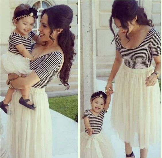 Mommy And Me Outfits: black and white striped short sleeve top, beige skirt, black shoes, black headband, bracelets #outfit #babygirl #mom #smile