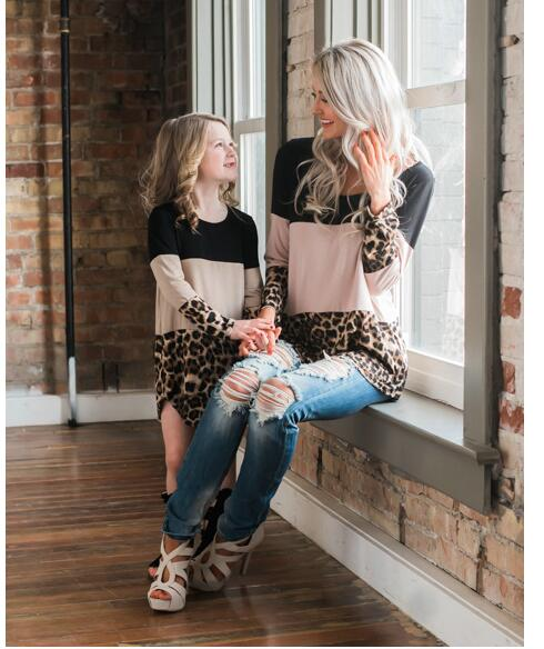 Mommy And Me Outfit: black, pink and leopard print long sleeve top/dress, ripped jeans, nude heel sandals, black gladiator shoes #outfit #blonde #trendy #mommy