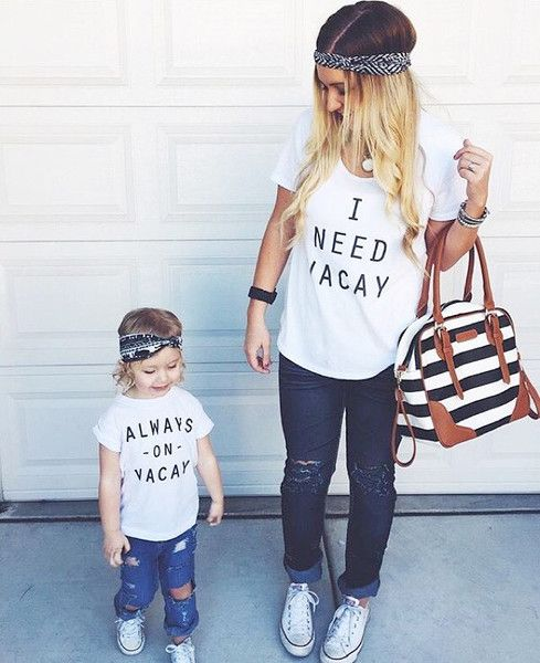 Mommy And Me Outfits: white t-shirt, ripped jeans, black and white headband, black and white striped bag, white sneakers, bracelets #outfit #mommy #babygirl #cute