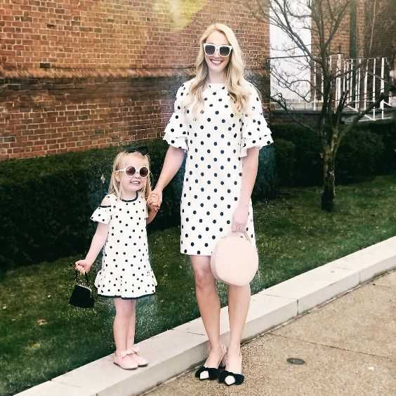 Mommy And Me Outfit: black and white point print ruffle dress, nude flats, nude and black heels, black purse, beige purse, sunglasses #outfit #happiness #babygirl #trendy