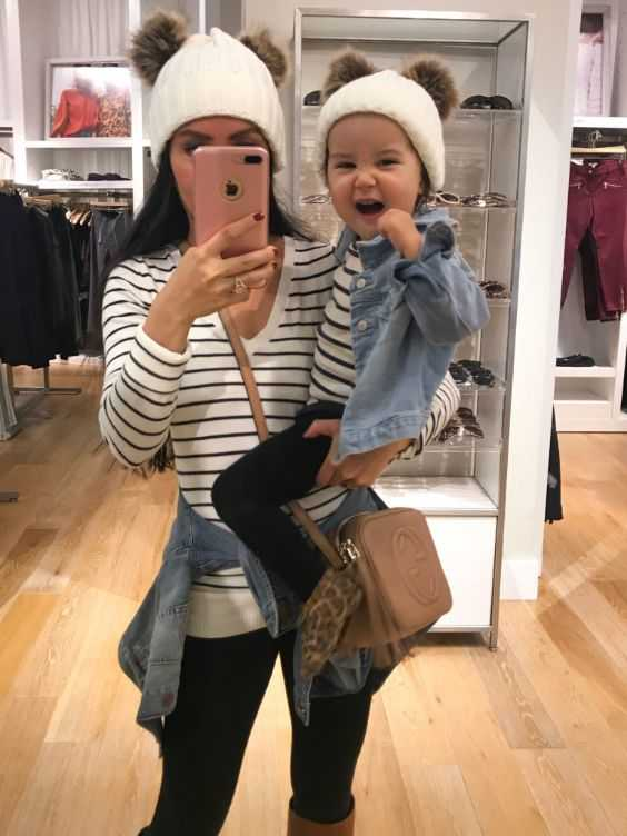 Mommy And Me Outfit: black and white striped v-neck shirt, denim jacket, white winter hat, black skinny pants, brown crossbody bag #outfit #mom #baby #happiness