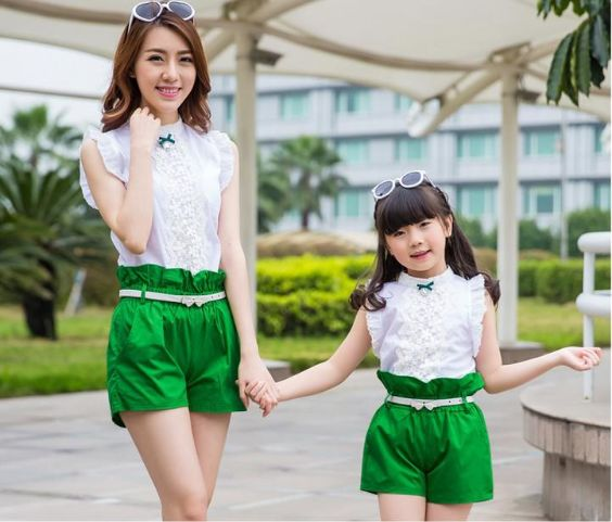 Mommy And Me Outfit: white turtleneck sleeveless shirt, green high waisted shorts, white belt, sunglasses #outfitideas #mommy #girl #cute