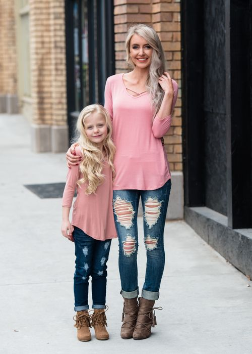 Mommy And Me Outfits: pink long sleeve cross front blouse, ripped jeans, brown booties #outfit #pink #girl #cute
