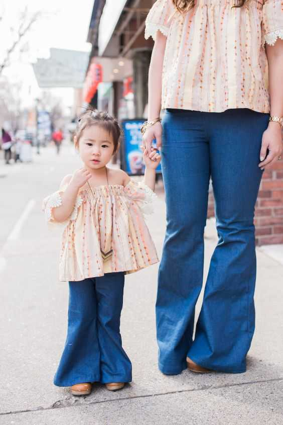 Mommy And Me Outfits: pink flounce sleeve blouse, flared jeans, camel shoes, necklace #outfit #baby #pink #girl