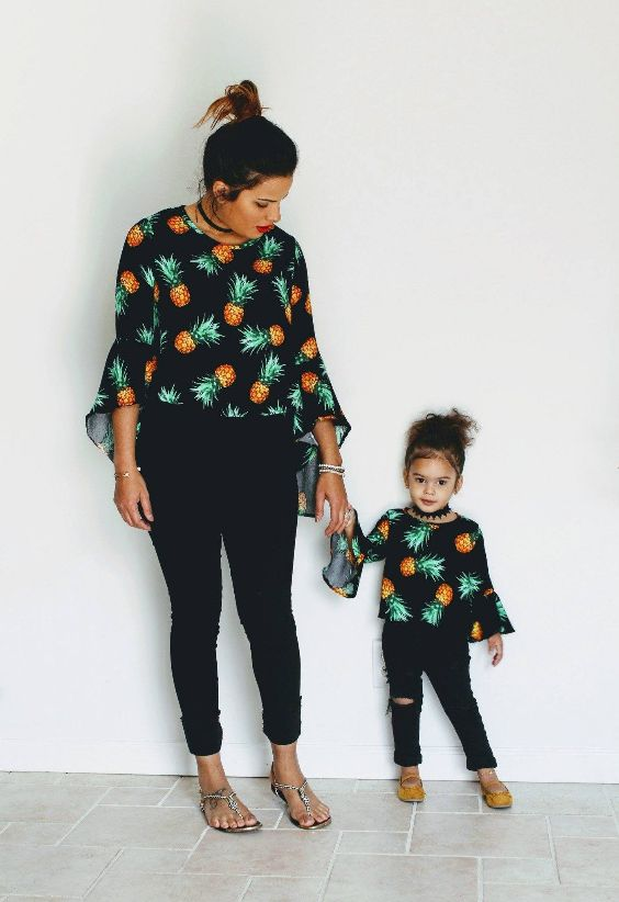 Mommy And Me Outfits: black pineapple print trumpet sleeve chiffon blouse, black skinny pants, nude sandals, yellow slip-on shoes, choker, bracelet #outfitideas #baby #trendy #pineapple